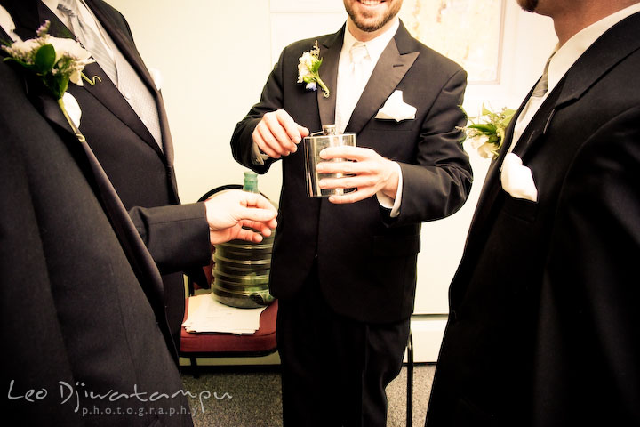 Groom, best man, and groomsmen having a drink before the ceremony. Kitty Knight House Georgetown Chestertown MD Wedding Photographer
