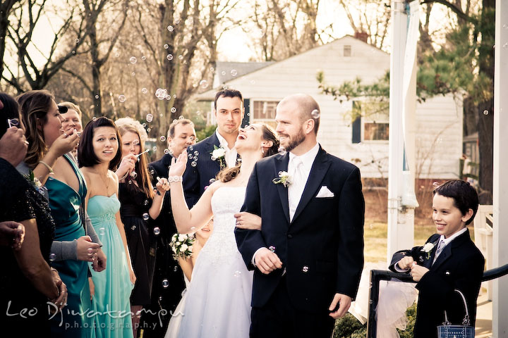 Bride and groom exiting Hope Fellowship Church greeted with bubbles. Kitty Knight House Georgetown Chestertown MD Wedding Photographer
