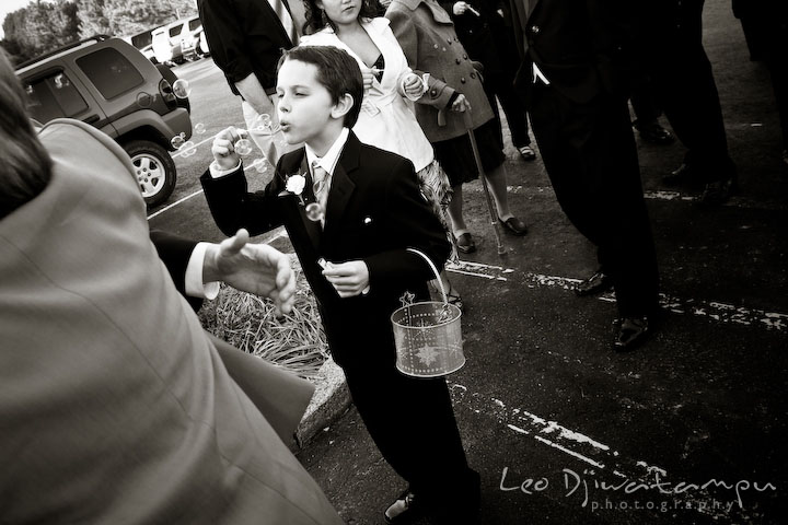 Boy blowing bubble to bride and groom at Hope Fellowship Church. Kitty Knight House Georgetown Chestertown MD Wedding Photographer