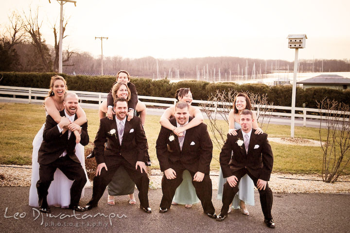 Bride, groom, best man, maid of honor, groomsmen, and bridesmaids having fun posing. Kitty Knight House Georgetown Chestertown MD Wedding Photographer
