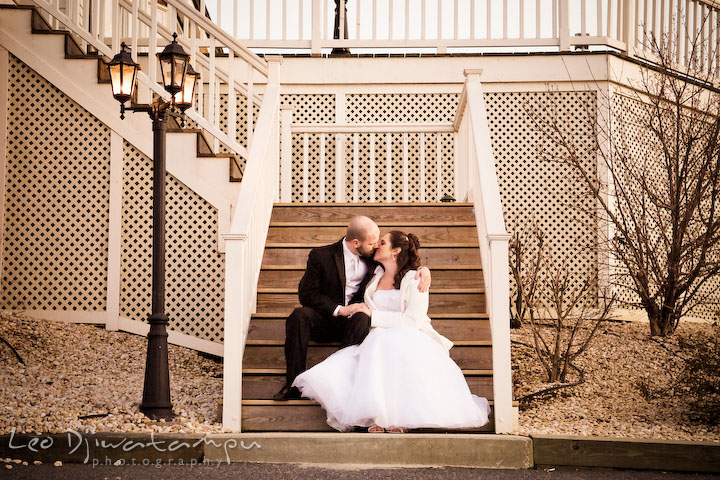 Bride and groom kissing on stair steps. Kitty Knight House Georgetown Chestertown MD Wedding Photographer
