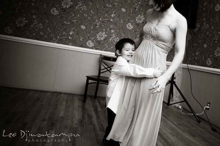 Son hugging her mom, one of the bridesmaid. Kitty Knight House Georgetown Chestertown MD Wedding Photographer