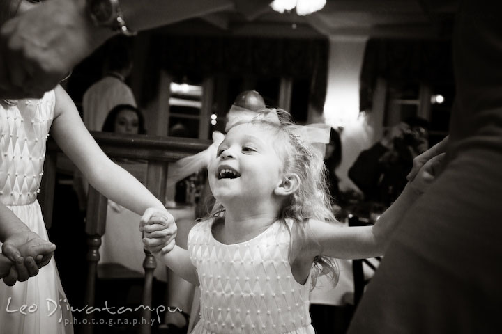 The flower girl dancing. Kitty Knight House Georgetown Chestertown MD Wedding Photographer
