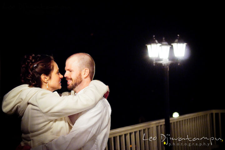 Bride and groom cuddling, hugging each other on the terrace. Kitty Knight House Georgetown Chestertown MD Wedding Photographer