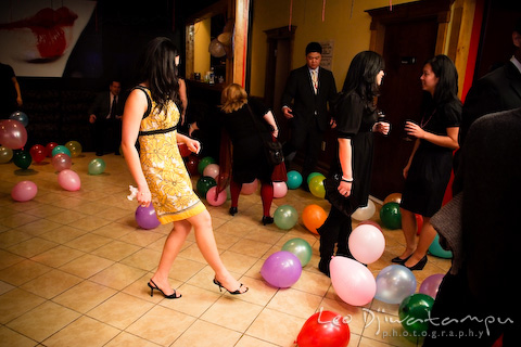girl clearing balloons from dance floor