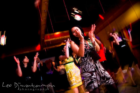girls clapping hand dancing at party