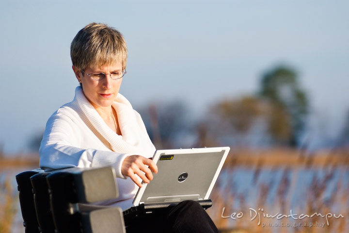Women writer looking and working on her laptop computer. Commercial work book writer portrait photographer Annapolis, Kent Island, Eastern Shore, Maryland