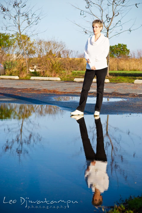 Lady writer posing, reflection on water. Commercial work book writer portrait photographer Annapolis, Kent Island, Eastern Shore, Maryland