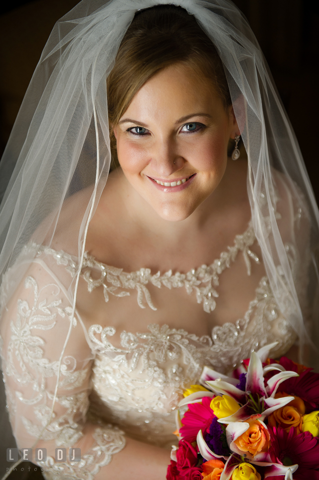 Beauty shot of Bride in her wedding dress, with veil and flower bouquet. The Tidewater Inn wedding, Easton, Eastern Shore, Maryland, by wedding photographers of Leo Dj Photography. http://leodjphoto.com