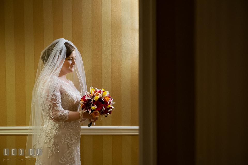 Shot of Bride looking at her bouquet. The Tidewater Inn wedding, Easton, Eastern Shore, Maryland, by wedding photographers of Leo Dj Photography. http://leodjphoto.com