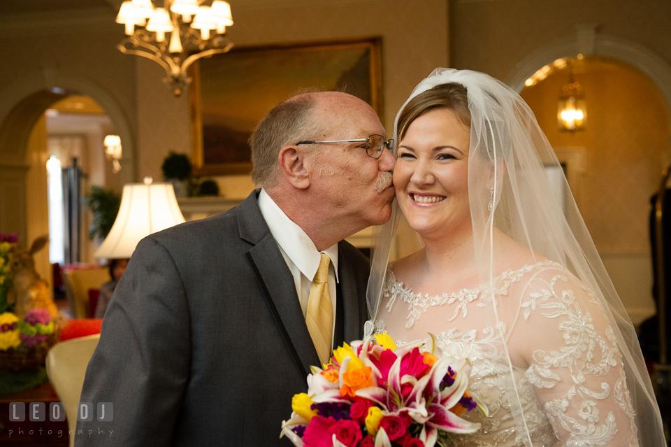 Father kissing the Bride. The Tidewater Inn wedding, Easton, Eastern Shore, Maryland, by wedding photographers of Leo Dj Photography. http://leodjphoto.com