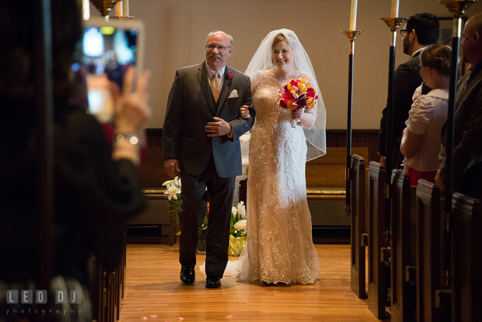 Bride walking down the aisle escorted by her Father. The Trinity Cathedral wedding, Easton, Eastern Shore, Maryland, by wedding photographers of Leo Dj Photography. http://leodjphoto.com
