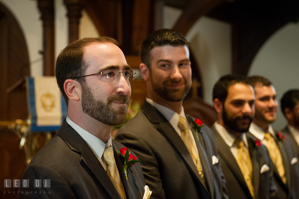 Groom was so moved by the first sight of his Bride, as she walked down the aisle escorted by her father. The Trinity Cathedral wedding, Easton, Eastern Shore, Maryland, by wedding photographers of Leo Dj Photography. http://leodjphoto.com