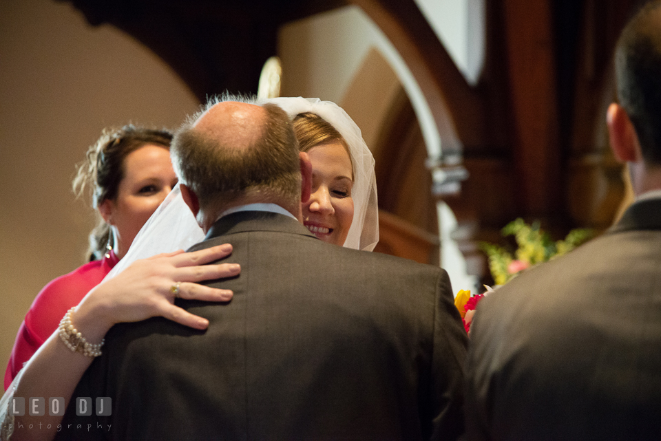 Bride hugging her Father as he was giving her away. The Trinity Cathedral wedding, Easton, Eastern Shore, Maryland, by wedding photographers of Leo Dj Photography. http://leodjphoto.com
