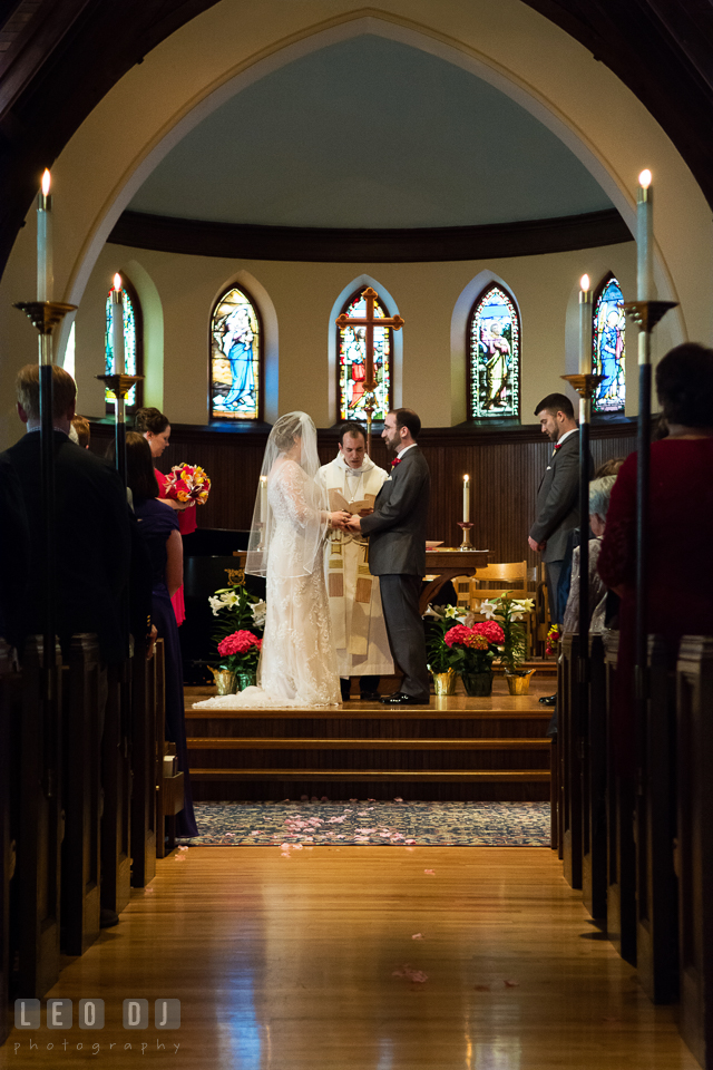 Bride and Groom holding hands during the ceremony. The Trinity Cathedral wedding, Easton, Eastern Shore, Maryland, by wedding photographers of Leo Dj Photography. http://leodjphoto.com