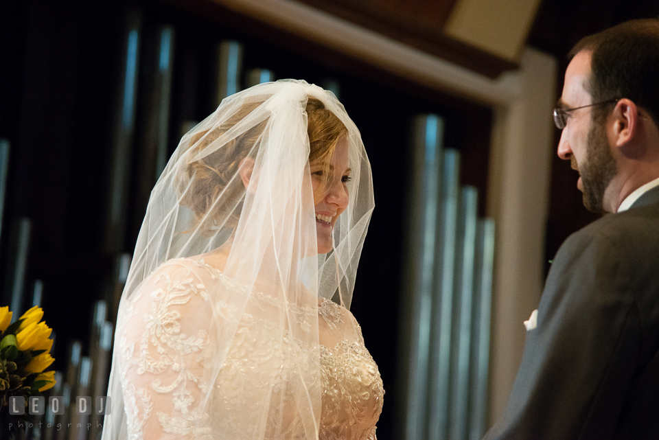 Bride smiling as she was listening to Groom reciting his vows. The Trinity Cathedral wedding, Easton, Eastern Shore, Maryland, by wedding photographers of Leo Dj Photography. http://leodjphoto.com
