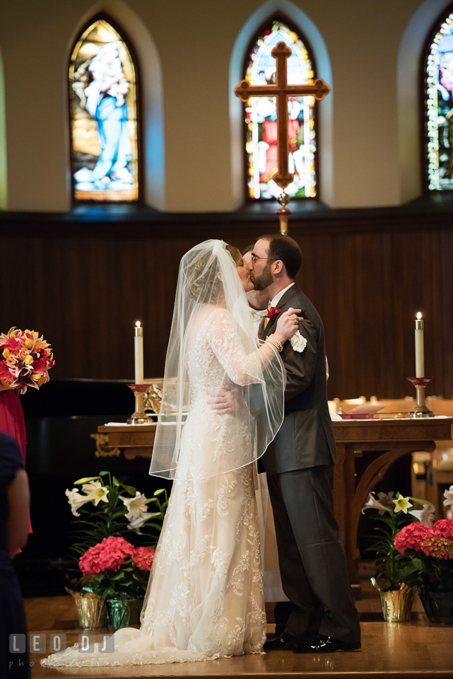 Bride and Groom kissing after officially pronounced as husband and wife. The Trinity Cathedral wedding, Easton, Eastern Shore, Maryland, by wedding photographers of Leo Dj Photography. http://leodjphoto.com