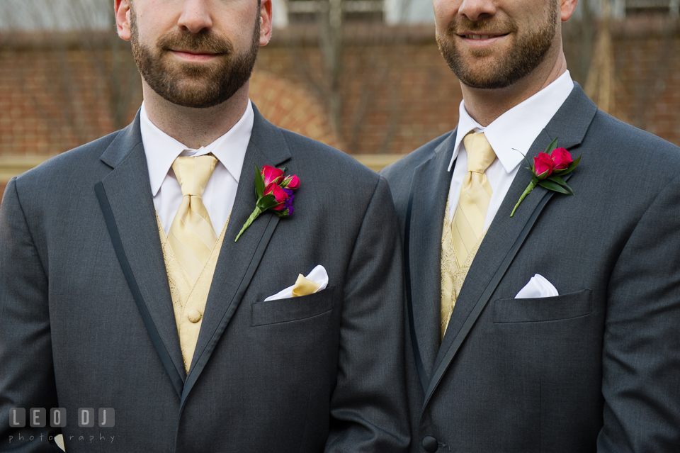Groom and Best Man showing their boutonniere by Florist Robin's Nest. The Tidewater Inn wedding, Easton, Eastern Shore, Maryland, by wedding photographers of Leo Dj Photography. http://leodjphoto.com