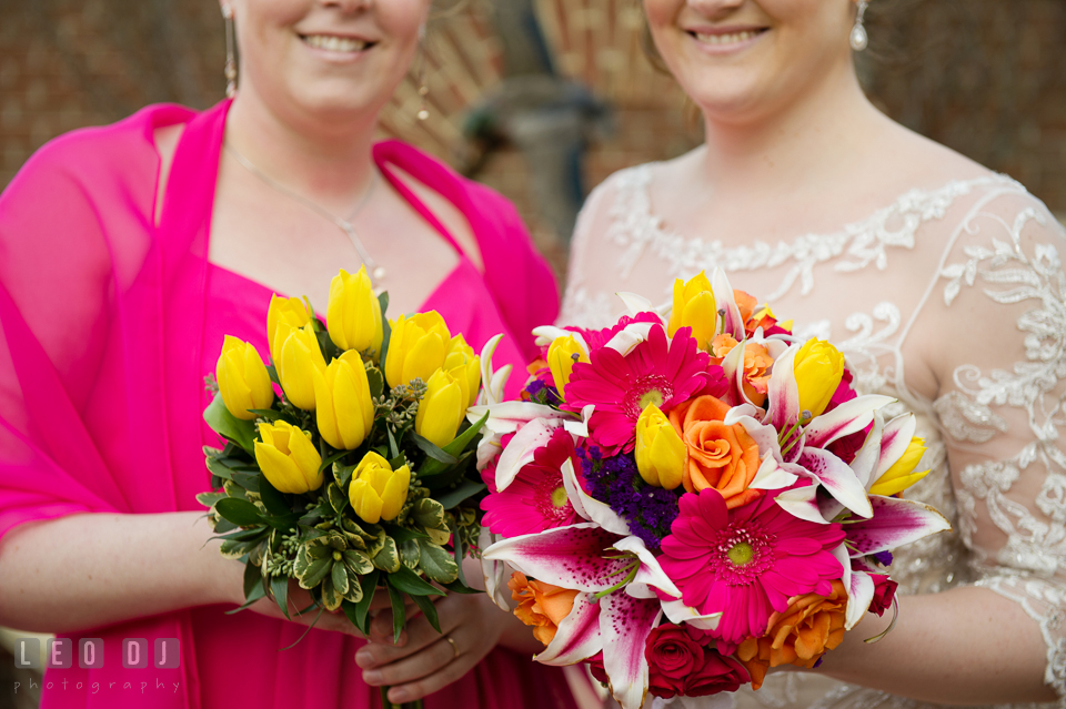 Bride and Matron of Honor showing their flower bouquets by Florist Robin's Nest. The Tidewater Inn wedding, Easton, Eastern Shore, Maryland, by wedding photographers of Leo Dj Photography. http://leodjphoto.com