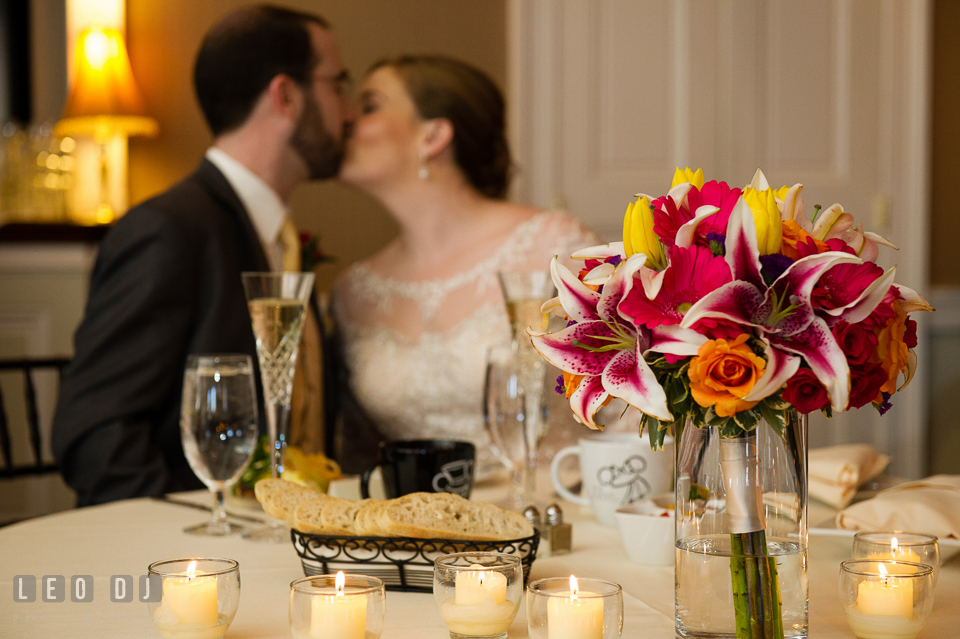 Bride and Groom kissing by the sweetheart table. The Tidewater Inn wedding, Easton, Eastern Shore, Maryland, by wedding photographers of Leo Dj Photography. http://leodjphoto.com