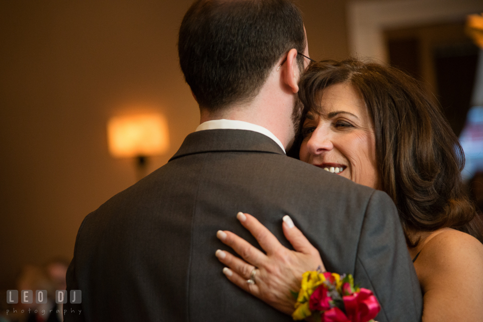 Mom smiling while hugging Groom during Mother-Son dance. The Tidewater Inn wedding, Easton, Eastern Shore, Maryland, by wedding photographers of Leo Dj Photography. http://leodjphoto.com