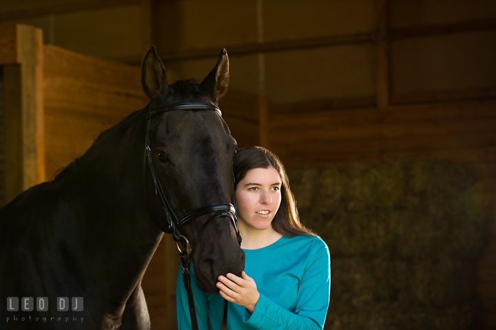 Portait of a girl and her horse. Montgomery County high school senior portrait session at Wyndham Oaks, Boyds, Maryland horse stables by photographer Leo Dj Photography. http://leodjphoto.com