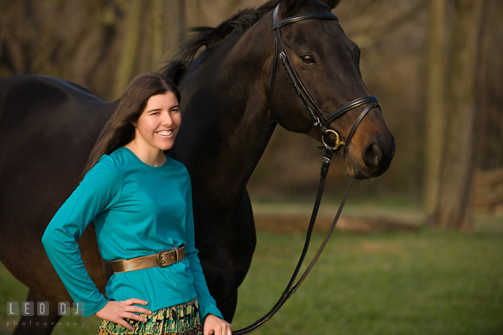 Girl smiling and posing with her horse. Montgomery County high school senior portrait session at Wyndham Oaks, Boyds, Maryland horse stables by photographer Leo Dj Photography. http://leodjphoto.com