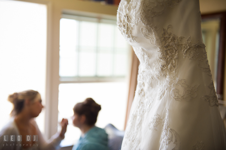 Detail of Bride's wedding gown with Bride getting make up in the background. Kent Island Maryland Matapeake Beach wedding ceremony and getting ready photo, by wedding photographers of Leo Dj Photography. http://leodjphoto.com