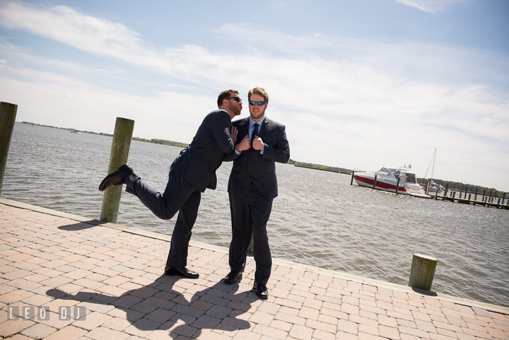 Best Man pretending to kiss Groom at Hilton Garden Inn boat pier. Kent Island Maryland Matapeake Beach wedding ceremony and getting ready photo, by wedding photographers of Leo Dj Photography. http://leodjphoto.com
