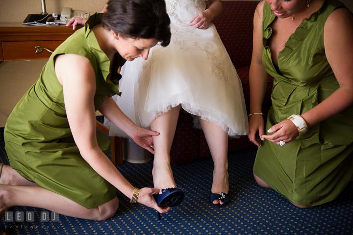Bridesmaid and Maid of Honor help putting shoes on Bride. Kent Island Maryland Matapeake Beach wedding ceremony and getting ready photo, by wedding photographers of Leo Dj Photography. http://leodjphoto.com
