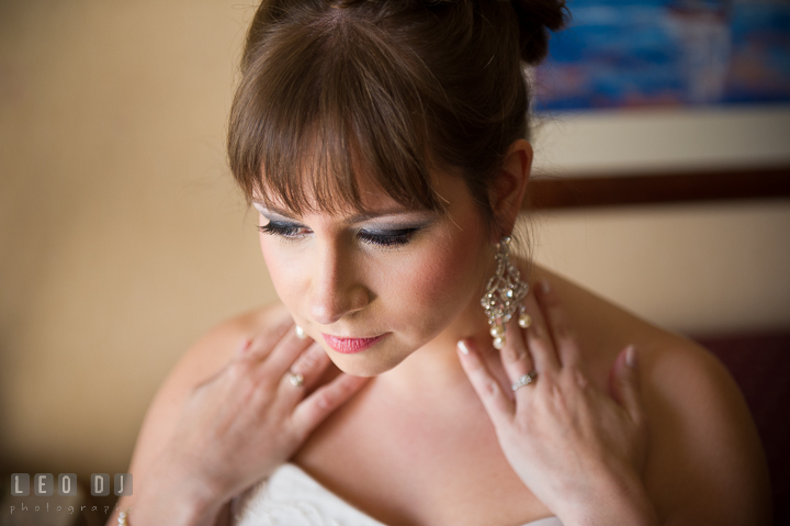 Bride showing her earrings. Kent Island Maryland Matapeake Beach wedding ceremony and getting ready photo, by wedding photographers of Leo Dj Photography. http://leodjphoto.com