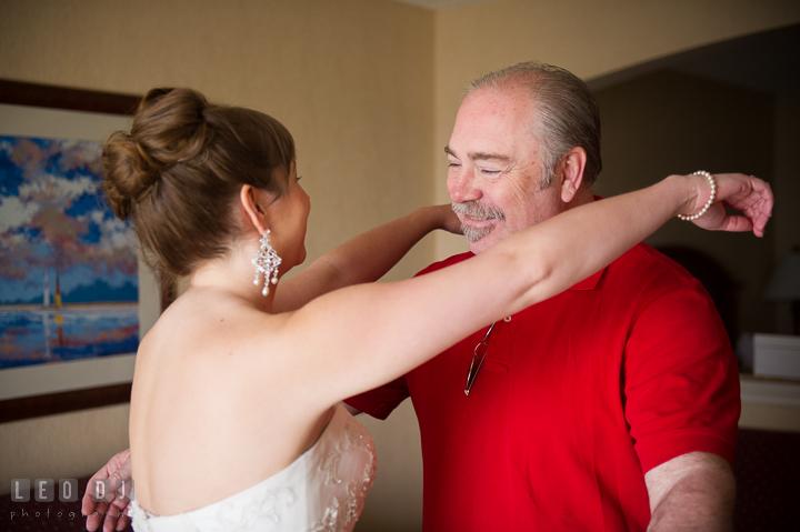 Bride trying to hug Father. Kent Island Maryland Matapeake Beach wedding ceremony and getting ready photo, by wedding photographers of Leo Dj Photography. http://leodjphoto.com