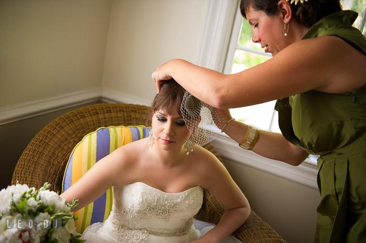 Maid of Honor help putting on veil on bride. Kent Island Maryland Matapeake Beach wedding ceremony and getting ready photo, by wedding photographers of Leo Dj Photography. http://leodjphoto.com