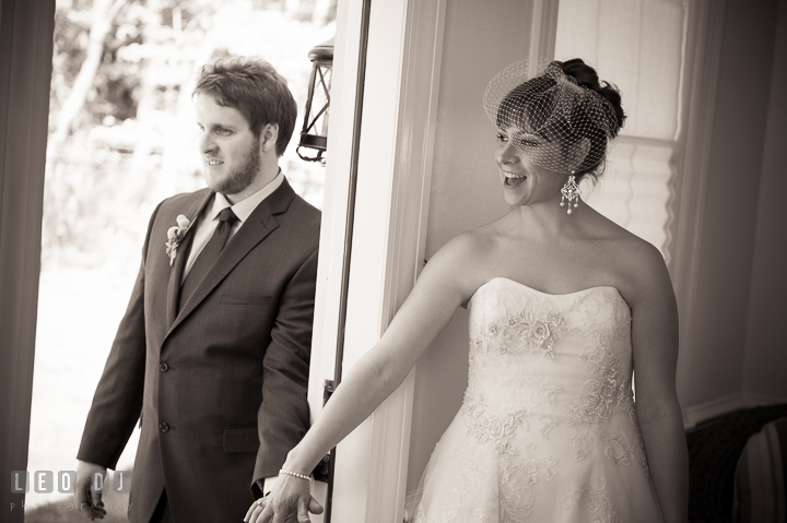 Bride and Groom holding hands before they see each other during the ceremony. Kent Island Maryland Matapeake Beach wedding ceremony and getting ready photo, by wedding photographers of Leo Dj Photography. http://leodjphoto.com