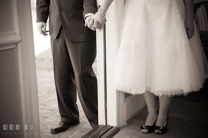 Bride and groom not seeing each other but holding hands by door. Kent Island Maryland Matapeake Beach wedding ceremony and getting ready photo, by wedding photographers of Leo Dj Photography. http://leodjphoto.com