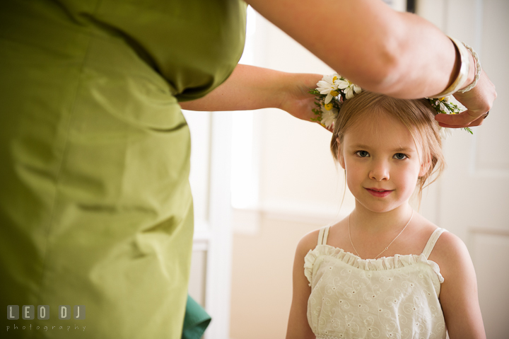 Maid of Honor put daisy flower crown on flower girl's head. Kent Island Maryland Matapeake Beach wedding ceremony and getting ready photo, by wedding photographers of Leo Dj Photography. http://leodjphoto.com