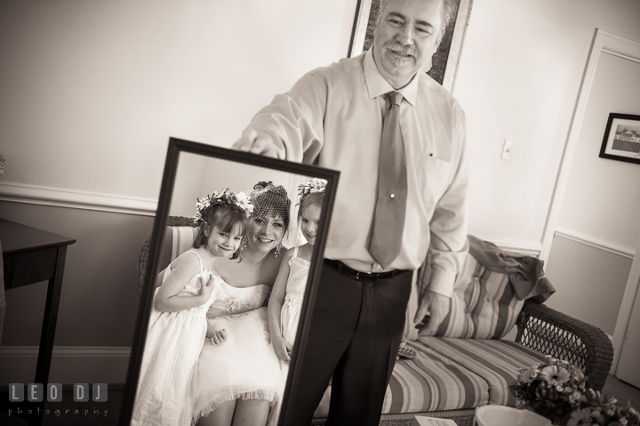 Father of Bride holding a mirror for Bride and flower girls to see themselves. Kent Island Maryland Matapeake Beach wedding ceremony and getting ready photo, by wedding photographers of Leo Dj Photography. http://leodjphoto.com