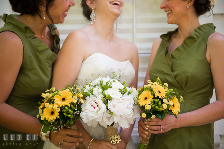Maid of Honor, Bride and Bridesmaid laughing and showing their yellow and white flower bouquets. Kent Island Maryland Matapeake Beach wedding ceremony and getting ready photo, by wedding photographers of Leo Dj Photography. http://leodjphoto.com