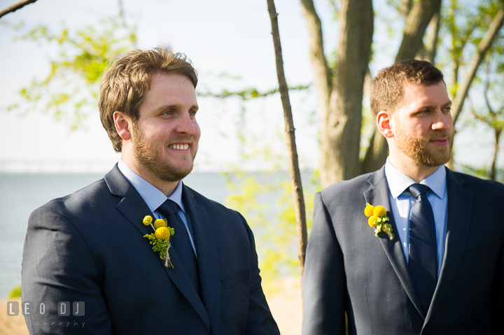 Groom smiling seeing Bride the first time in her wedding gown. Kent Island Maryland Matapeake Beach wedding ceremony and getting ready photo, by wedding photographers of Leo Dj Photography. http://leodjphoto.com