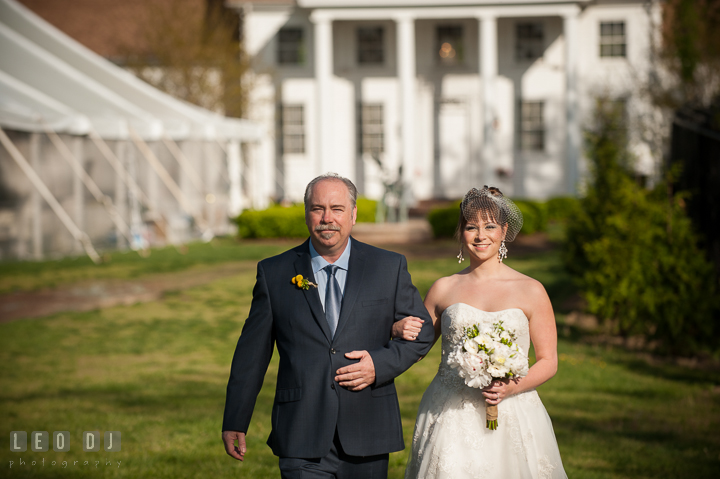Father of the Bride escorting his daughter walk down the isle. Kent Island Maryland Matapeake Beach wedding ceremony and getting ready photo, by wedding photographers of Leo Dj Photography. http://leodjphoto.com