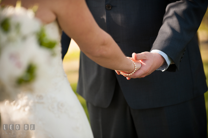 Bride and Groom holding each other's hands. Kent Island Maryland Matapeake Beach wedding ceremony and getting ready photo, by wedding photographers of Leo Dj Photography. http://leodjphoto.com