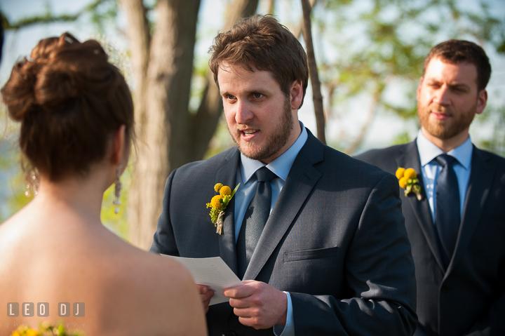 Groom reading vow to Bride. Kent Island Maryland Matapeake Beach wedding ceremony and getting ready photo, by wedding photographers of Leo Dj Photography. http://leodjphoto.com