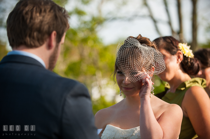 Bride crying and shed tear listening to Groom reading vow. Kent Island Maryland Matapeake Beach wedding ceremony and getting ready photo, by wedding photographers of Leo Dj Photography. http://leodjphoto.com