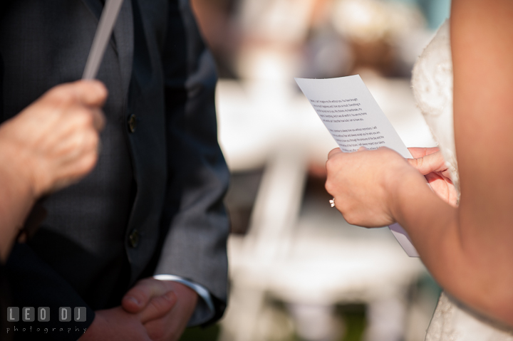 Bride reading her personalized vow to Groom. Kent Island Maryland Matapeake Beach wedding ceremony and getting ready photo, by wedding photographers of Leo Dj Photography. http://leodjphoto.com
