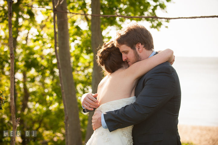 Bride and Groom hugged each other after they are officially married. Kent Island Maryland Matapeake Beach wedding ceremony and getting ready photo, by wedding photographers of Leo Dj Photography. http://leodjphoto.com