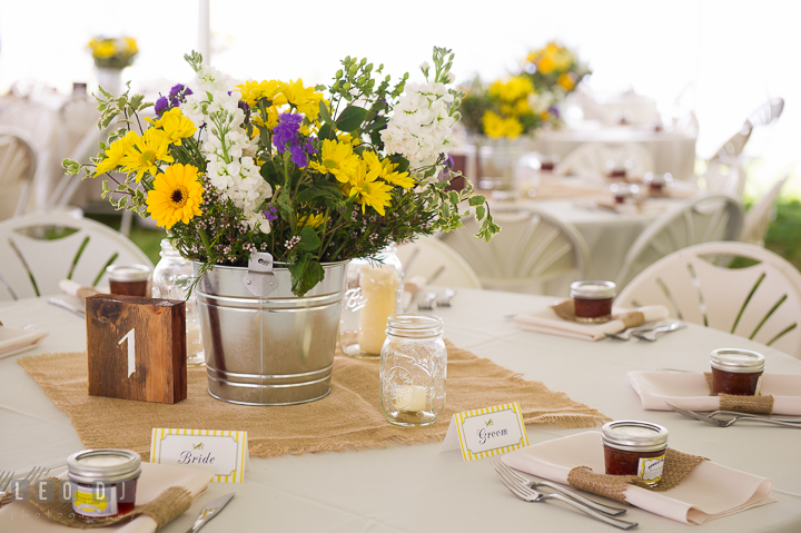 Sweetheart table with flower centerpiece and wooden table number. Kent Island Maryland Matapeake Beach wedding reception party and romantic session photo, by wedding photographers of Leo Dj Photography. http://leodjphoto.com