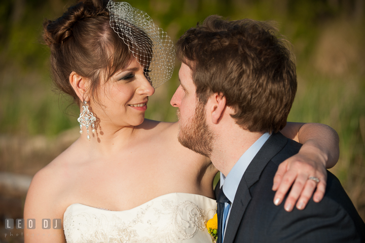 Bride and Groom looking at each other. Kent Island Maryland Matapeake Beach wedding reception party and romantic session photo, by wedding photographers of Leo Dj Photography. http://leodjphoto.com
