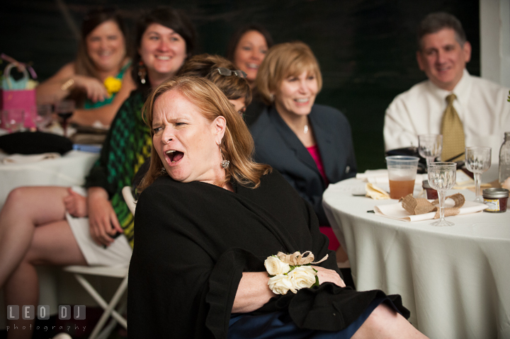 Mother of Bride surprised listening to Maid of Honor's toast speech. Kent Island Maryland Matapeake Beach wedding reception party and romantic session photo, by wedding photographers of Leo Dj Photography. http://leodjphoto.com