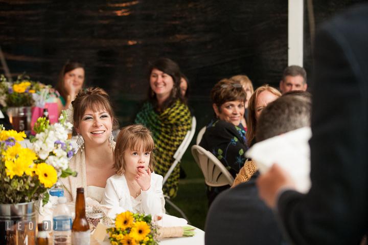 Bride laughing listening to Best Man's toast speech. Kent Island Maryland Matapeake Beach wedding reception party and romantic session photo, by wedding photographers of Leo Dj Photography. http://leodjphoto.com