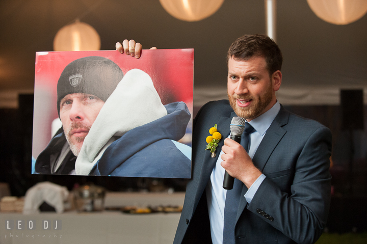 Best Man showing picture of NFL player Kerry Collins to guests during his toast speech. Kent Island Maryland Matapeake Beach wedding reception party and romantic session photo, by wedding photographers of Leo Dj Photography. http://leodjphoto.com